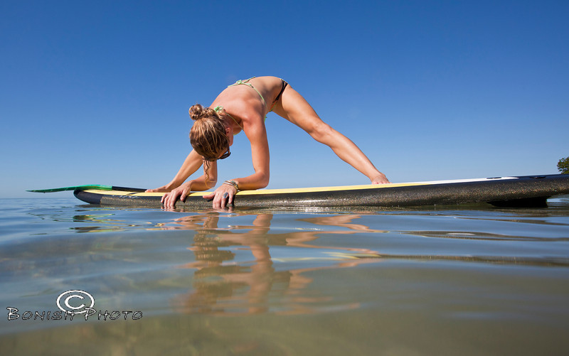 Stretching on the Paddle Board with Alexa Mae - Mellow Ventures Key West - Photo by Pat Bonish