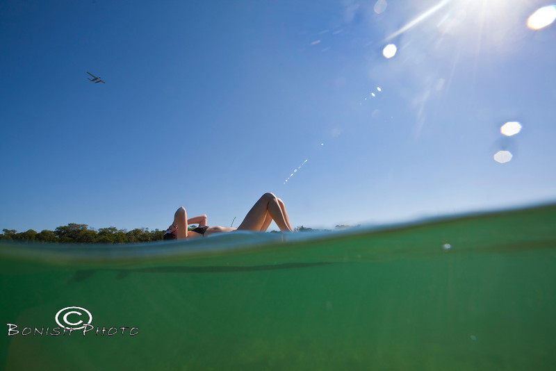Lounging on the Paddle Board while the Float Plane heads to the Dry Tortugas - Mellow Ventures Key West - Photo by Pat Bonish