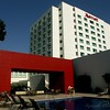 The Tijuana Marriott has a totally useless red arch beside the pool. Useless except for the stunning visual design.