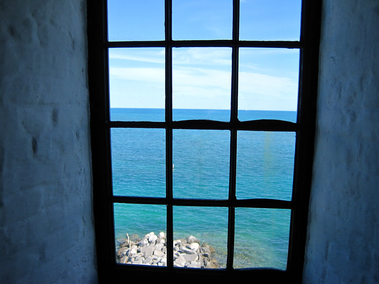 Looking out thru one of the windows as we climb the lighthouse.