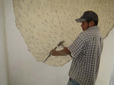 A worker captured in a renovation of one the many colonial houses that are popular with foreigners n Merida