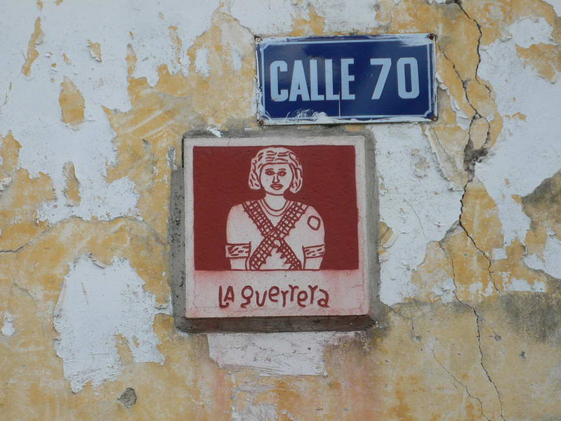 """corner """"placas"""".  Street signs for the local Maya."""