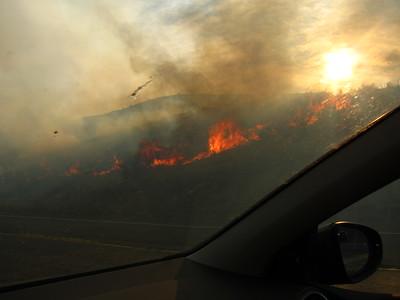 Nervously driving past the blaze