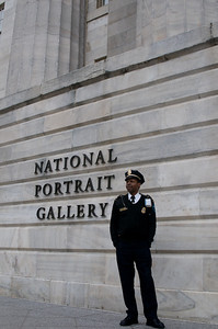 A guard of the National Portrait Gallery Museum in Chinatown poses unexpectedly as I captured this shot.