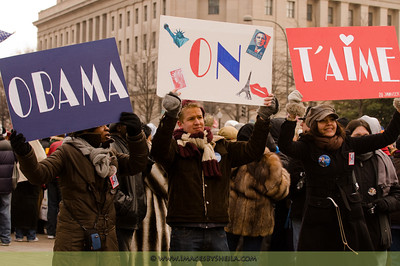 "These people shouted, ""Obama on t'aime"" as they pose for the NBC media along Pennsylvania Avenue during the Presidential Inaugural Parade - Jan 20, 2009."