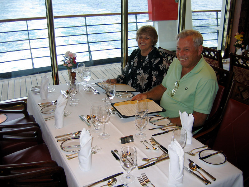 Our table in the main dining room. Right next to the aft windows. These are the Joneses, our dinner companions (some of them, at least).
