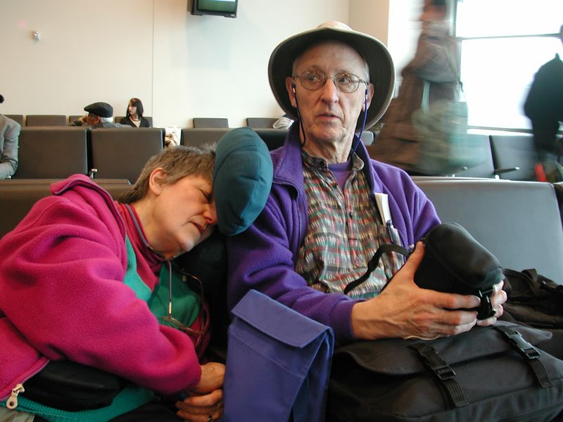 As we wait for our plane to leave San Francisco, Mom snoozes, as she (and I) were up all night packing the night before.