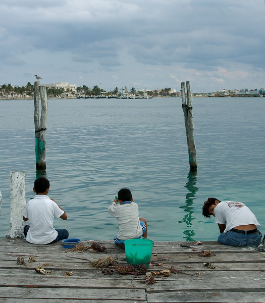 Some locals fishing from a pier on Isla Mujeres.