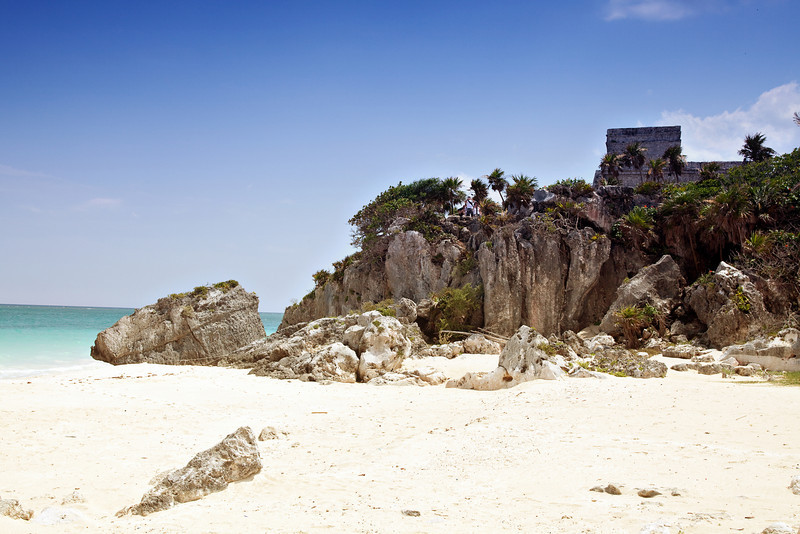 Ancient Mayan temple on the top of a cliff in Tulum, Mexico.