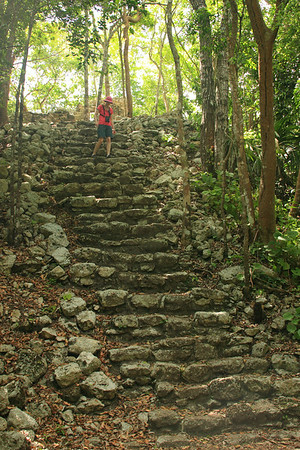 Stacy descending Mayan steps