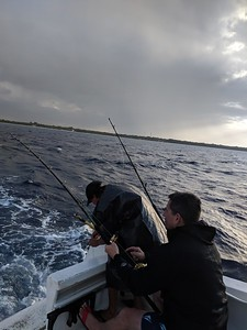 Reeling in a 20-pound Wahoo, the 1st of two fish we caught that day.