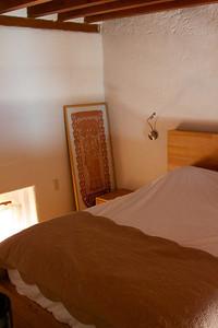 Lofted bedroom with wood beams.