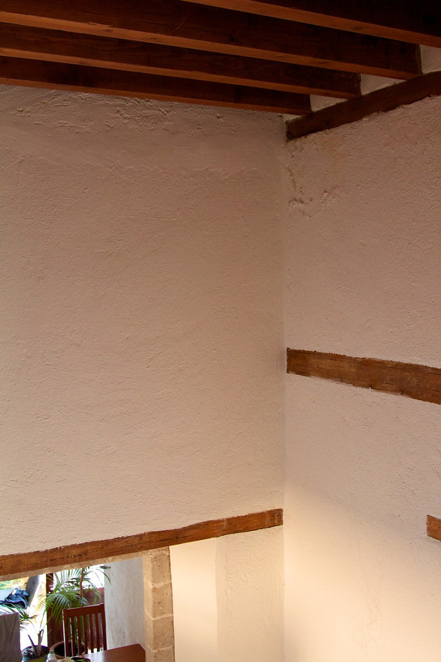Wood beams on ceiling and in walls.