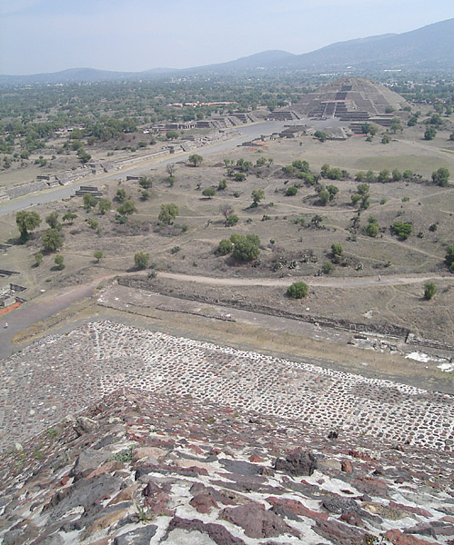 A view from near the summit of the Pyramid of the Sun, showing the Avenue of the Dead and the Pyramid of the Moon in the distance.