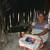 The mother making tortillas of freshly ground corn. They were delicious. She and her husband only speak Mayan but the children also speak Spanish. they have lived here for over 25 years.