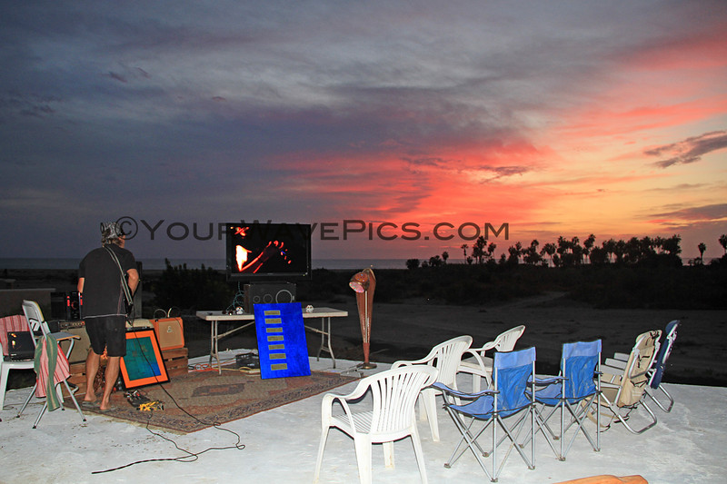 2017-12-02_San Pedrito_Sunset Slideshow_13.JPG<br /> <br /> My old friend, Andy Keller, surprised me by putting together a slide show featuring a few hundred of my photos of San Pedrito.  He added his own composition of a rock soundtrack which he performed Iive as we watched the amazing sunset in San Pedrito.