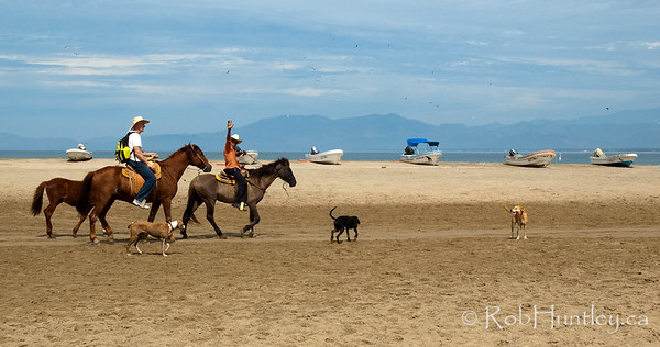 Horseback riding along the beach at Barra de Potosi, Mexico.