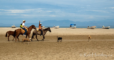 Horseback riding along the beach at Barra de Potosi, Mexico. © Rob Huntley