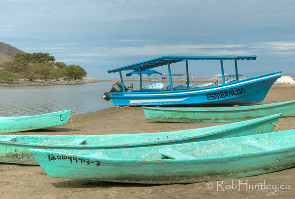 View of boats alongside the lagoon at Barra de Potosi, Mexico. © Rob Huntley
