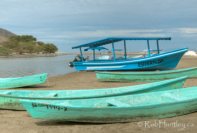 Boats alongside the lagoon at Barra de Potosi, Mexico.