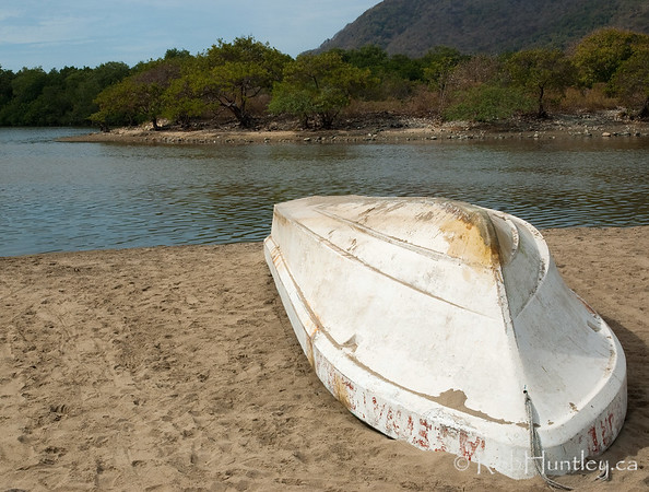 Overturned fishing boat alongside the lagoon at Barra de Potosi, Mexico. © Rob Huntley
