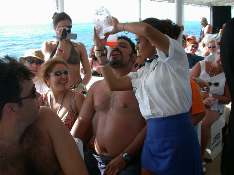 Isla Mujarres (Isle of Women) Sharing a rum drink on the way home.