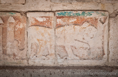 Jaguar carvings arcoss from the Templo de las Mesas, Chichen Itza