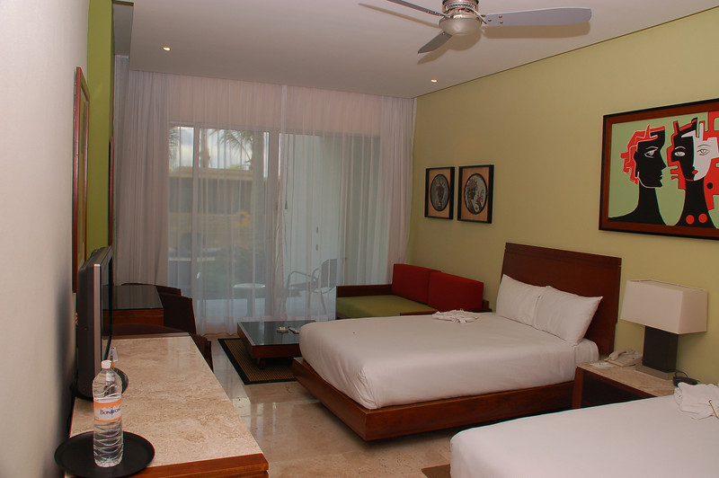 Second bedroom  with two queen size beds, sofa bed and sliding door to the terrace,  where Will keeps all his video and camera equipment.