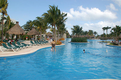 The on this side the pool is shared by the Mayan Palace guests
