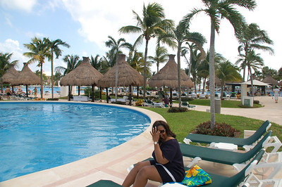 View of the pool / grounds, Tiki Huts and Palapas are the ones  with the white covered beds