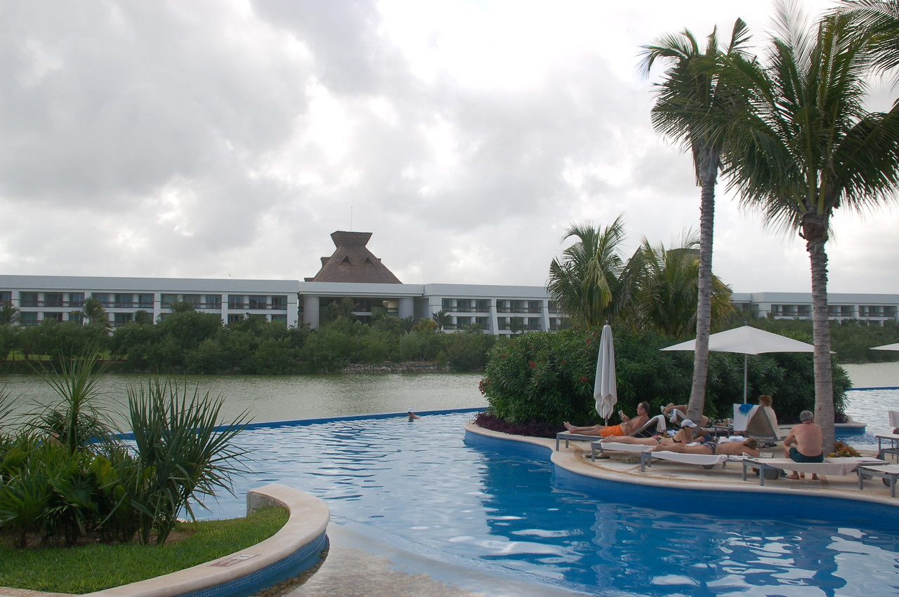 Private pool area with snack bar for Grand Mayan guests. View of the lake and buildings 6&7