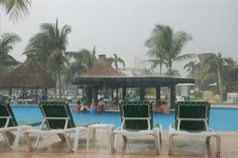 It' s really coming down, we  are safe under the Palapas enjoying happy hour and smooth jazz!!