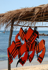 Lifejackets hanging at the ready on a beach in the Huatulco area, Mexico. © Rob Huntley