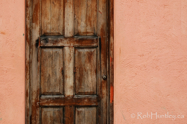 Weathered Door on Peach Stucco