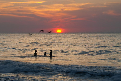 Another shot with the kids, some birds, and the sunset.