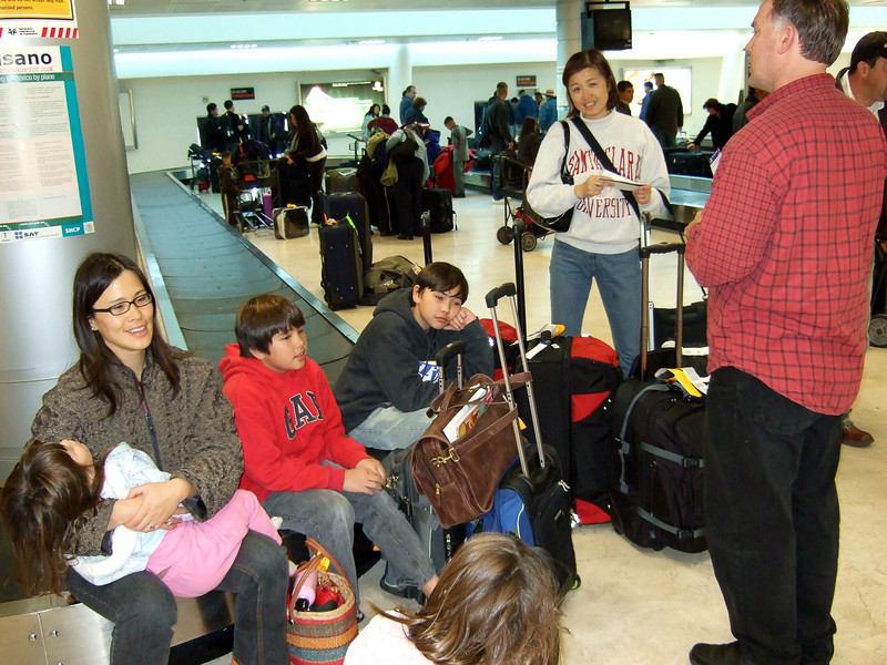 Sitting at the Guadalajara baggage claim, waiting to see if we can get put on a connecting flight.