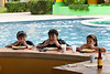 The kids enjoy lunch at the swim-up bar.