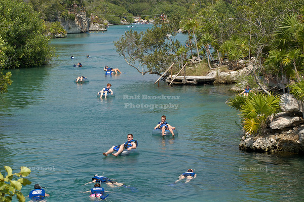 Tourists snorkeling or floating down the river at Xel-Ha, Yucatan, Mexico
