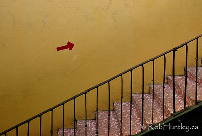Stairs to the second floor of shops in a small arcade in Oaxaca, Mexico. License this photo on Getty Images © Rob Huntley