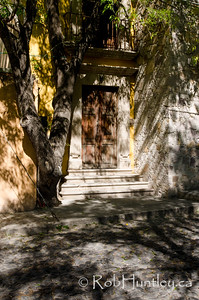 Shaded Entrance, Cobbled Road.