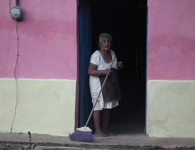 Women sweeping her home.