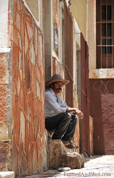 <strong><center><b>Mexican man waiting