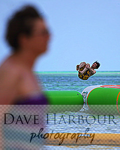 Carnival Triumph Cruise - Progresso - Cozumel - Isla Pasion - Woman Oblivious of Fun - Billy Harbour jumping (Model release available) - by Dave Harbour