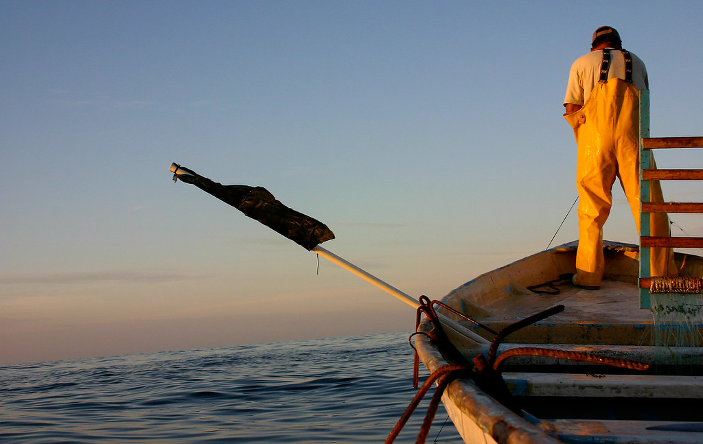 Fisherman at dawn, off the coast of Mazatlan Sinaloa, MX