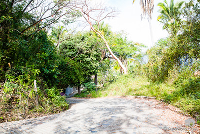 towards the top of jay's road. nicely paved streets with the ocean in the background