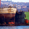 """A boat in the Ensenada Harbor with reflections in the water creating """"water paintings"""""""