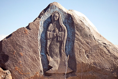 Lady of Guadalupe rock carving