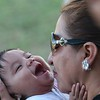 This poor baby was being kissed to death by joy by her Abuela (grandmother)