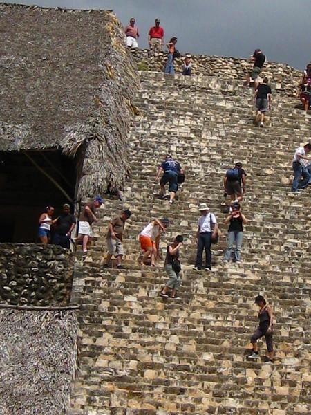 tourists climb the pyrimid at Ek Balem
