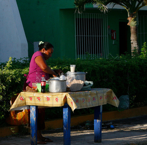 This woman serves up fresh tamales and tacos in the harbor each morning.
